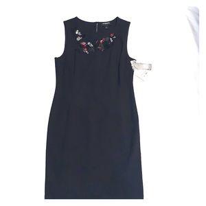 Black Dress with Distinctive Decor Neck line